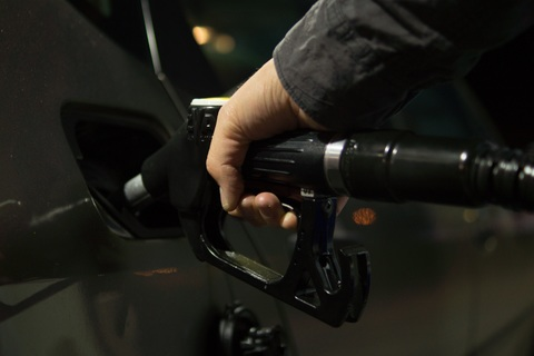 A picture of someone filling up a vehicle with fuel